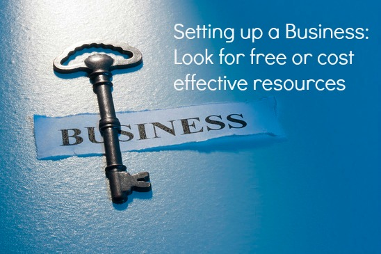 """A key laying on a piece of paper with the word """"business"""" on it."""