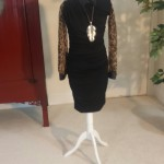 Little black dress with animal print blouse