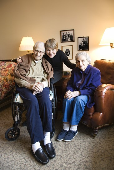 Daughter with elderly parents.