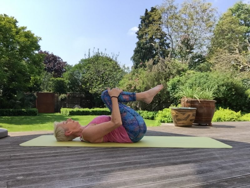 yoga knees to chest pose image