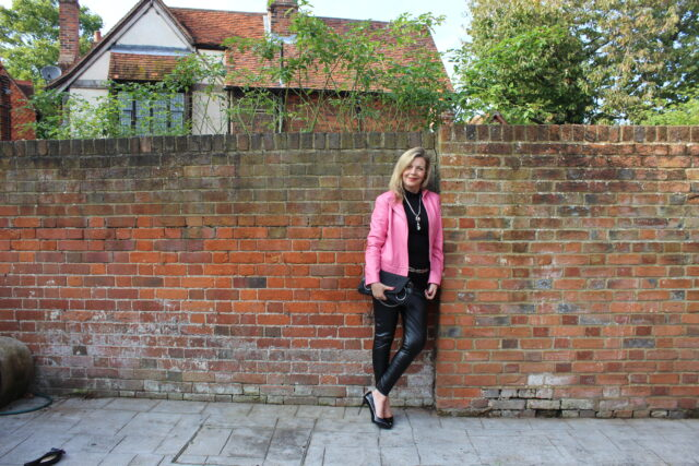 wearing a pink leather jacket to look fabulous over 50 image
