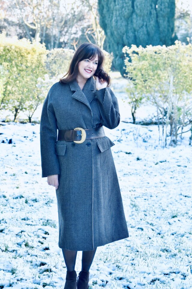 wear a statement coat over 50 image