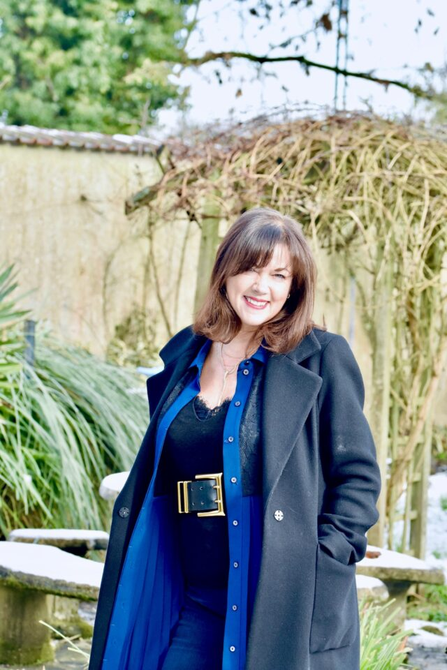 layering over 50 wear a dress as a duster jacket image